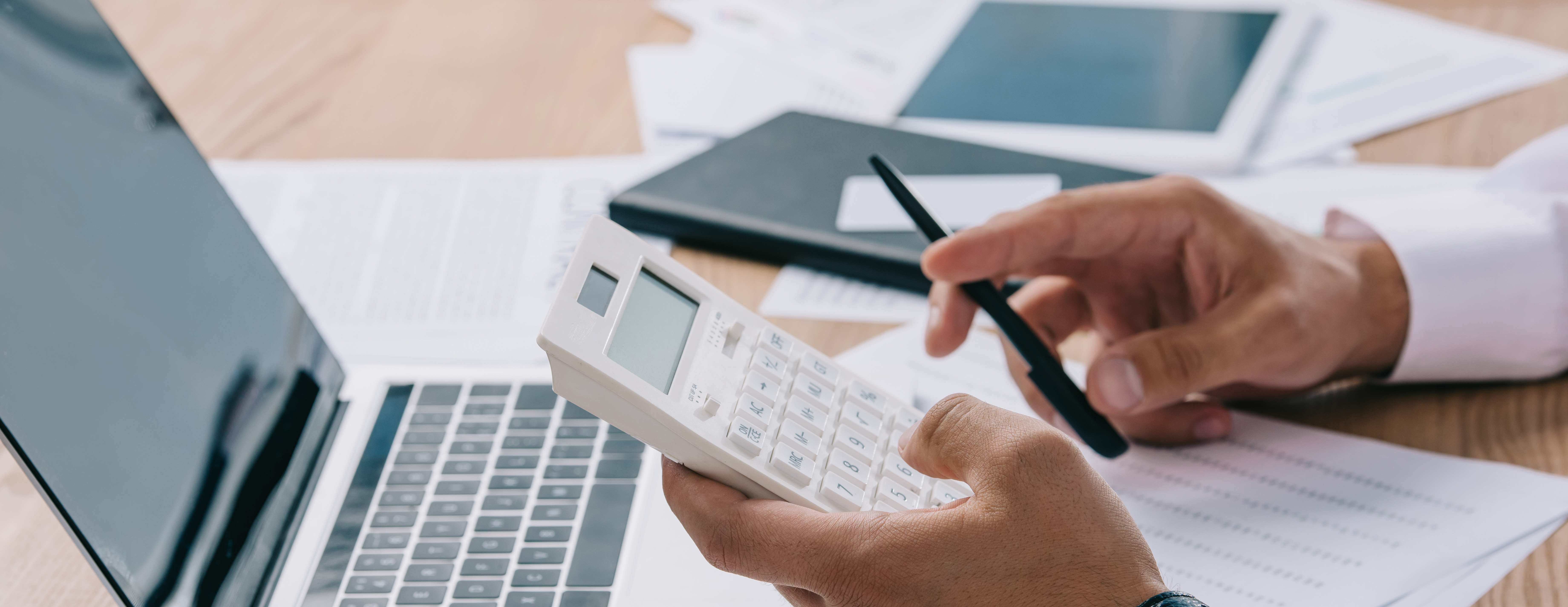 business man using calculator in office