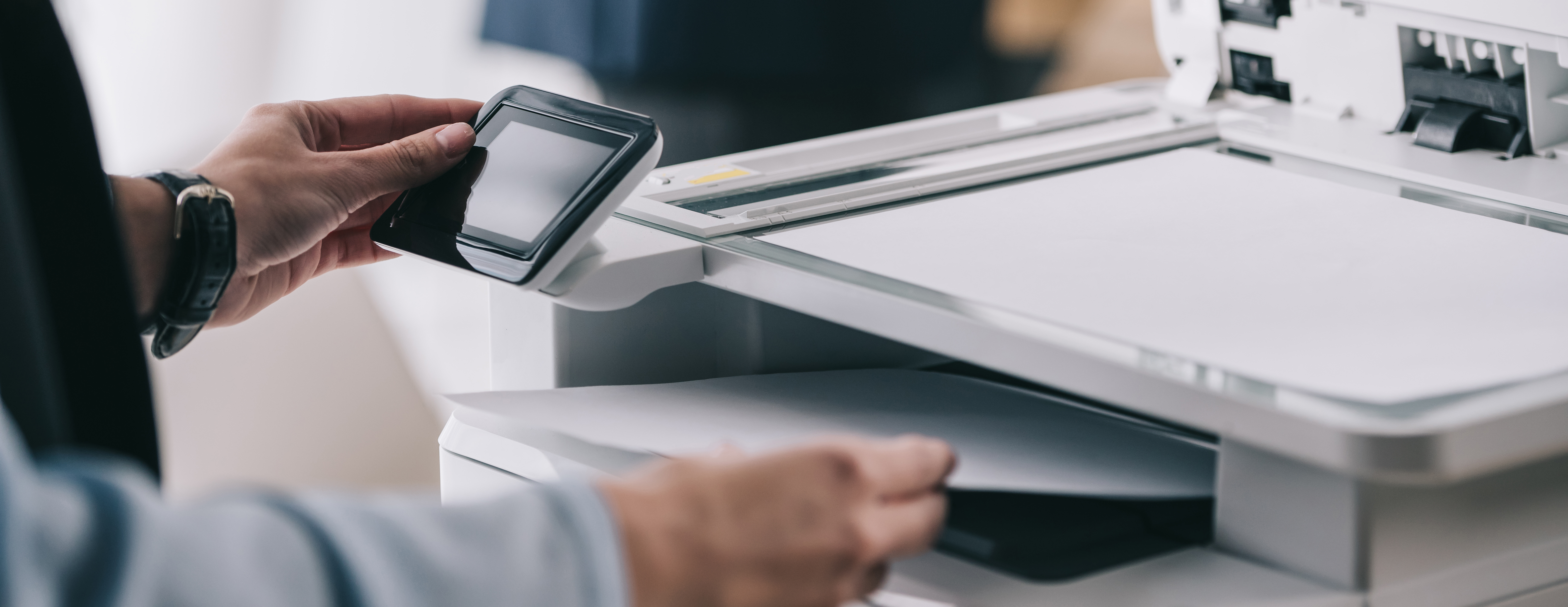 woman at office printer secure